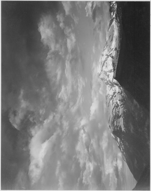 "Ansel Adams: Dark foreground and clouds, mountains highlighted, ""Heaven's Peak,"" Glacier National Park, Montana"