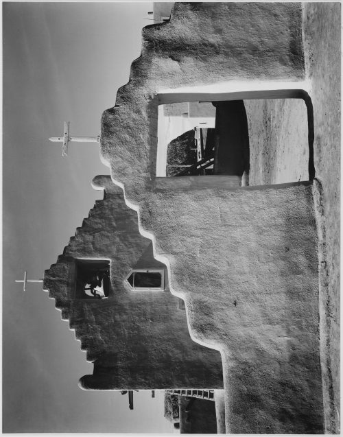 "Ansel Adams: Full side view of entrance with gate to the right, ""Church, Taos Pueblo National Historic Landmark, New Mexico, 1941."" [Misión de San Gerónimo]"