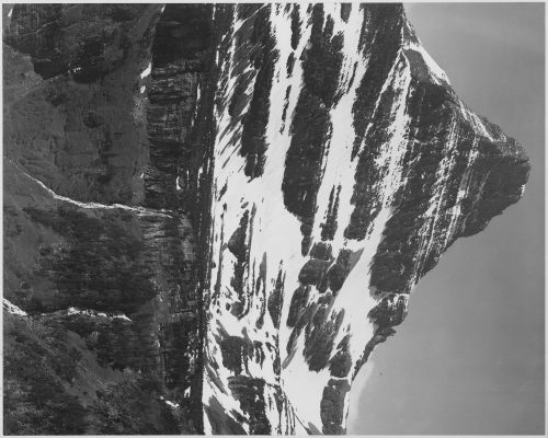"Ansel Adams: Full view of snow covered mountain, including area below timberline, ""In Glacier National Park,"" Montana"