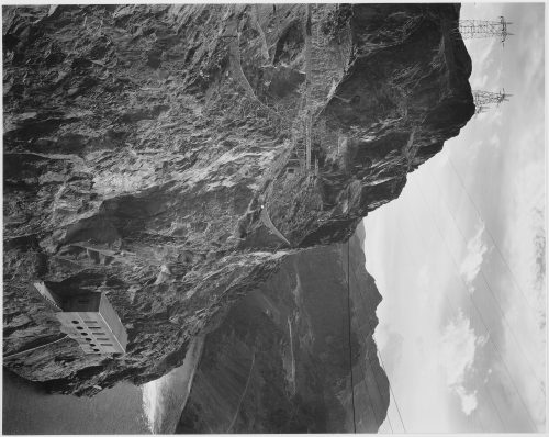 Ansel Adams: Photograph from Side of Cliff with Boulder Dam Transmission Lines Above and Colorado River to the Left