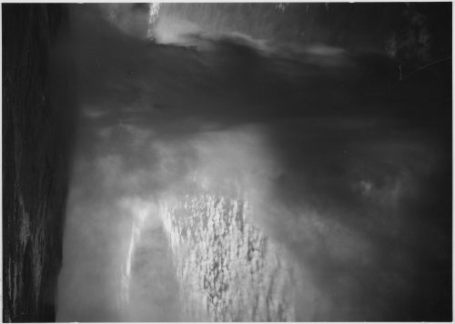 "Ansel Adams: Taken at dusk or dawn from various angles during eruption. ""Old Faithful Geyser, Yellowstone National Park,"" Wyoming"