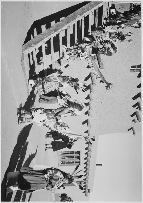 "Ansel Adams: Tewas in headdress, male and female, descending stairs, ""Dance, San Ildefonso Pueblo, New Mexico"