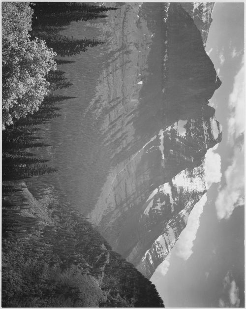 "Ansel Adams: Valley, snow covered mountains in background, ""In Glacier National Park,"" Montana"
