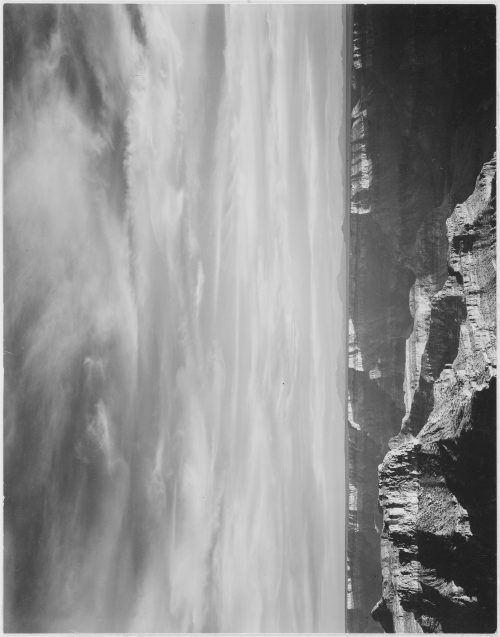 "Ansel Adams: View of canyon in foreground, horizon, mountains and clouded sky, from"" North Rim, 1941,"" "" Grand Canyon National Park,"" Arizona"