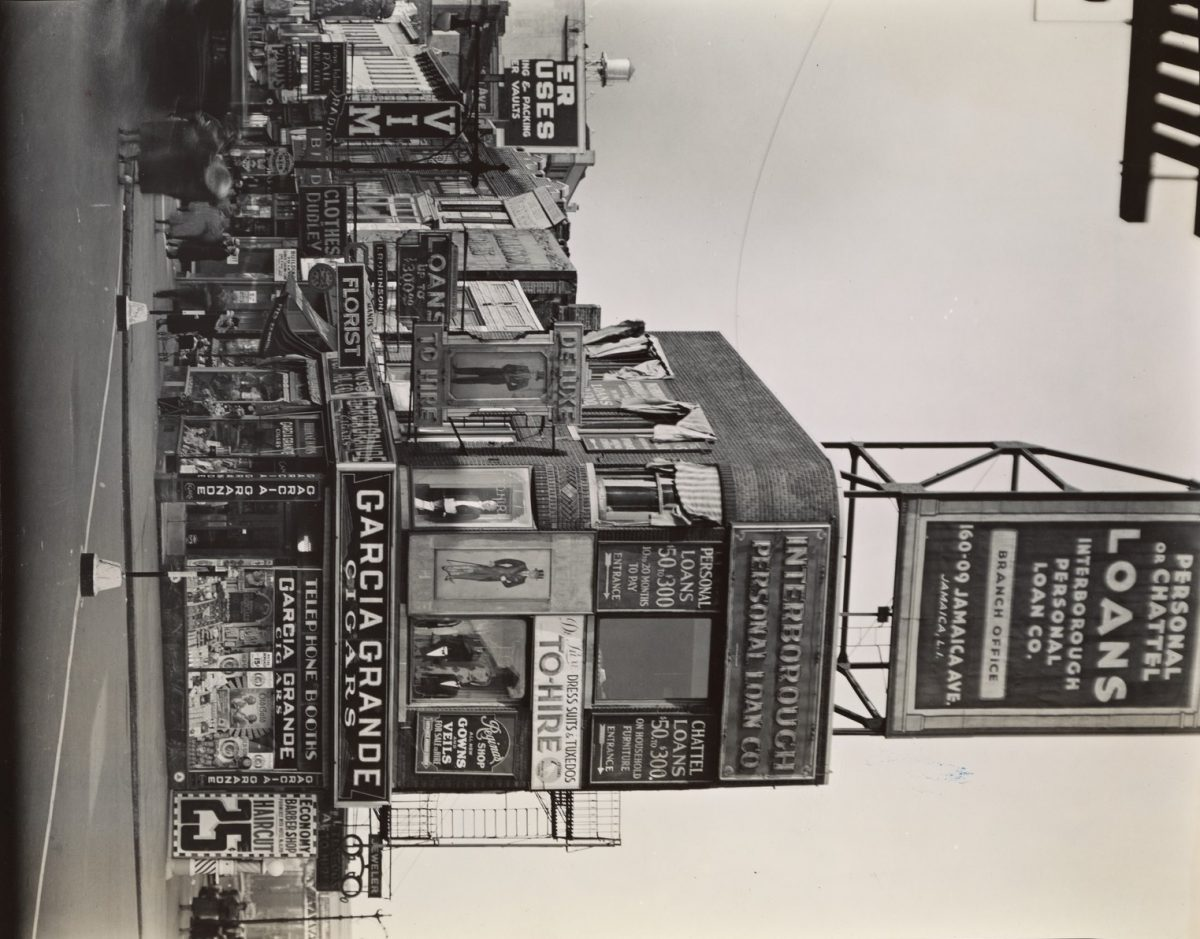 Berenice Abbott:  Billboards and signs, Fulton Street between State street and Ashland place, Brooklyn