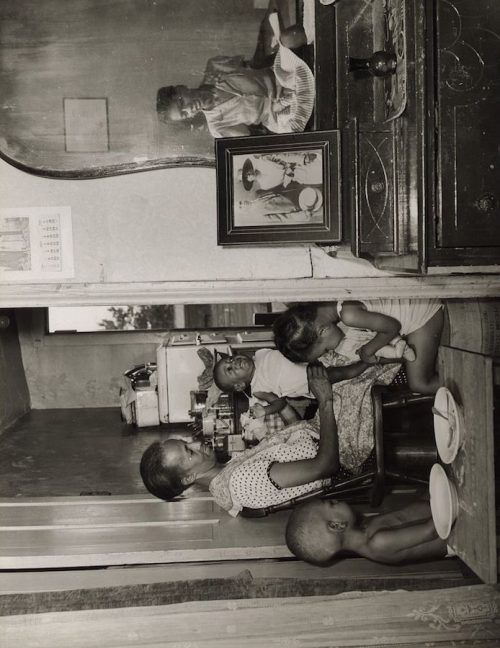 Gordon Parks: Mrs. Ella Watson, a government charwoman, with three grandchildren and her adopted daughter