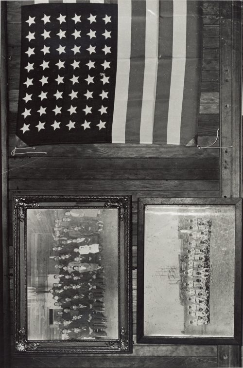 Dorothea Lange: Display of Flag and Japanese Family Photographs