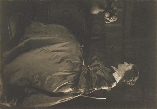 Gertrude Käsebier: [Self-portrait with Table and Flowers]