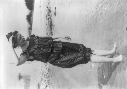 Frances Benjamin Johnston: [Frances Benjamin Johnston, standing in surf in wet bathing suit]