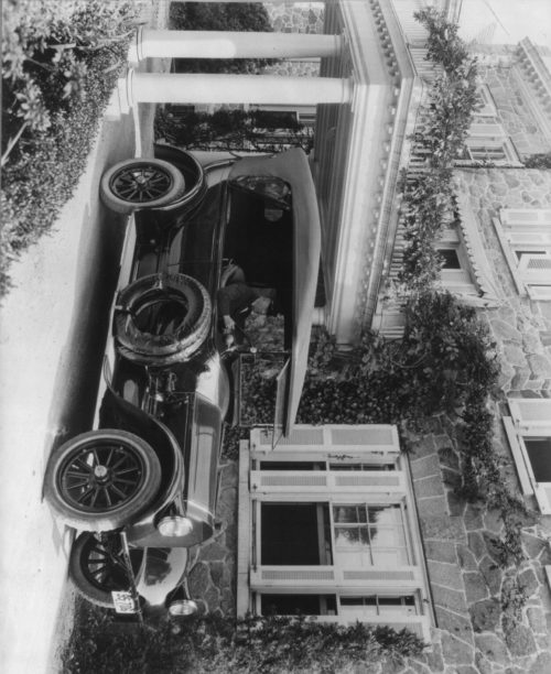 Frances Benjamin Johnston: Automobile owned by Mrs. Charles W. Richardson in driveway with driver at the wheel, Washington, D.C.