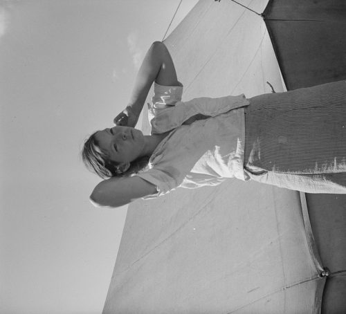 """Dorothea Lange: Woman in pea picker's camp. California. """"I seen our corn dry up and blow over the fence back there in Oklahoma"""""""
