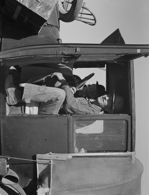 Dorothea Lange:  Texas family looking for work in the carrot harvest. California